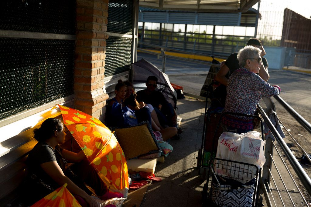 """Immigrants wait to be processed on the U.S. side of the international bridge in between Hidalgo, Texas, and Reynosa, Mexico, on June 9, 2018. At times, immigrants have camped for days on the bridge because U.S. Customs and Border Protection said they had """"housing capacity"""" issues."""