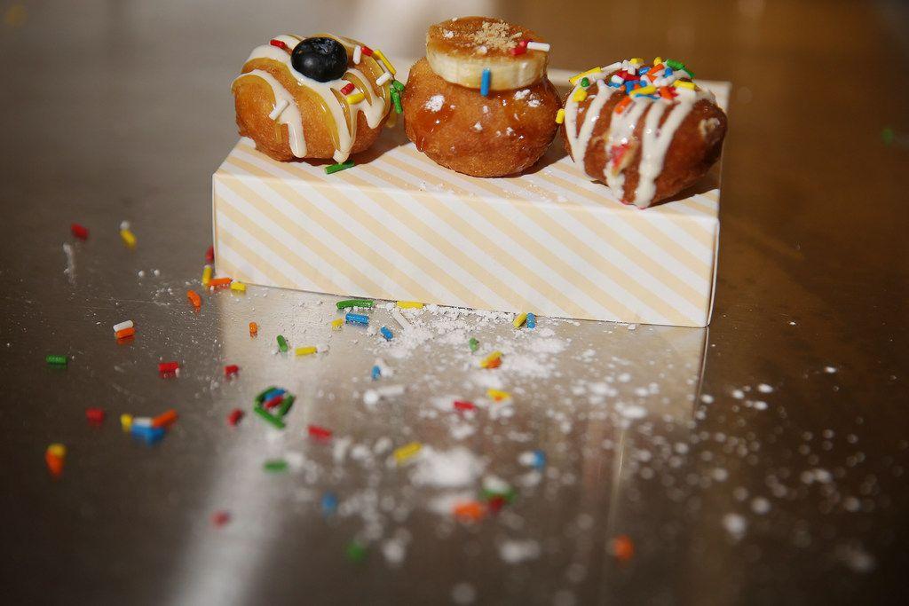 Lemon Blueberry, Banana Foster and vanilla glaze with sprinkles doughnuts.
