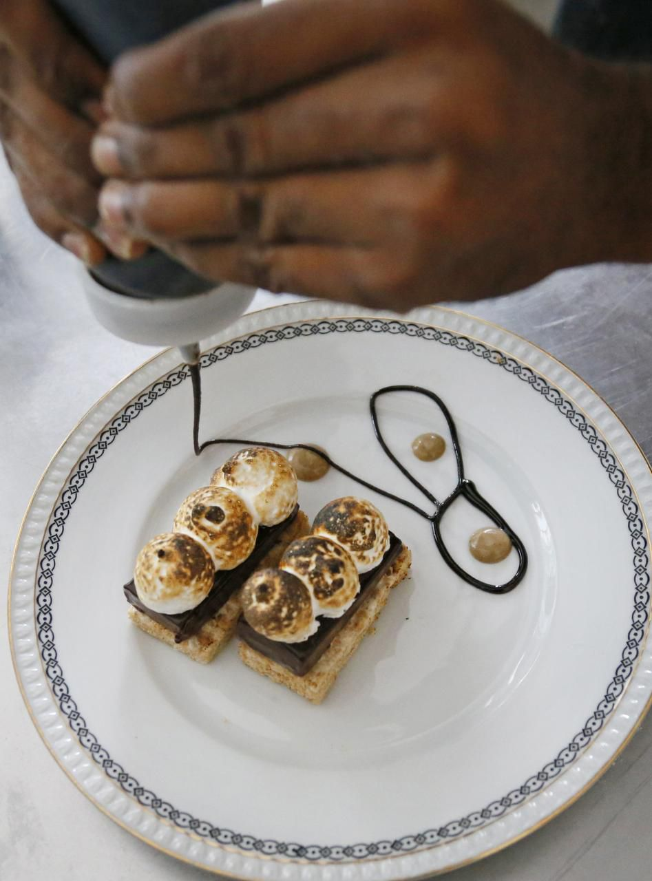Pastry intern Salifu Mansaray prepares S'more at Café Momentum during his Friday evening shift.