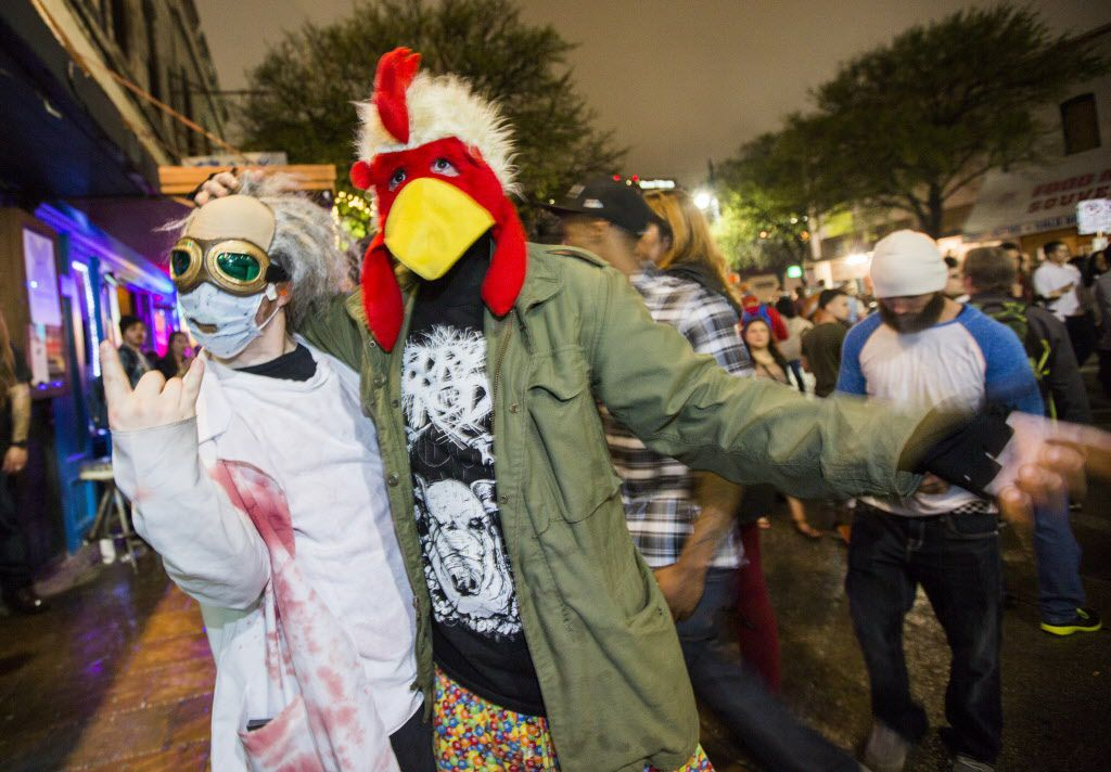 Dahk-Tore Smoldyface and Tsar-Djent Peckerhead of the band Sausage Fingers pose for a photo on Sixth Street during the SXSW music festival on Saturday, March 21, 2015.