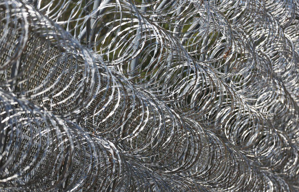 FOR BRANDI SWICEGOOD STORY A closeup look at some of the razor wire on the fence at the Ramsay I Unit at the Texas Department of Corrections W.F. Ramsey Unit in Rosharon,Texas, photographed on Tuesday, September 12, 2017. (Louis DeLuca/The Dallas Morning News)