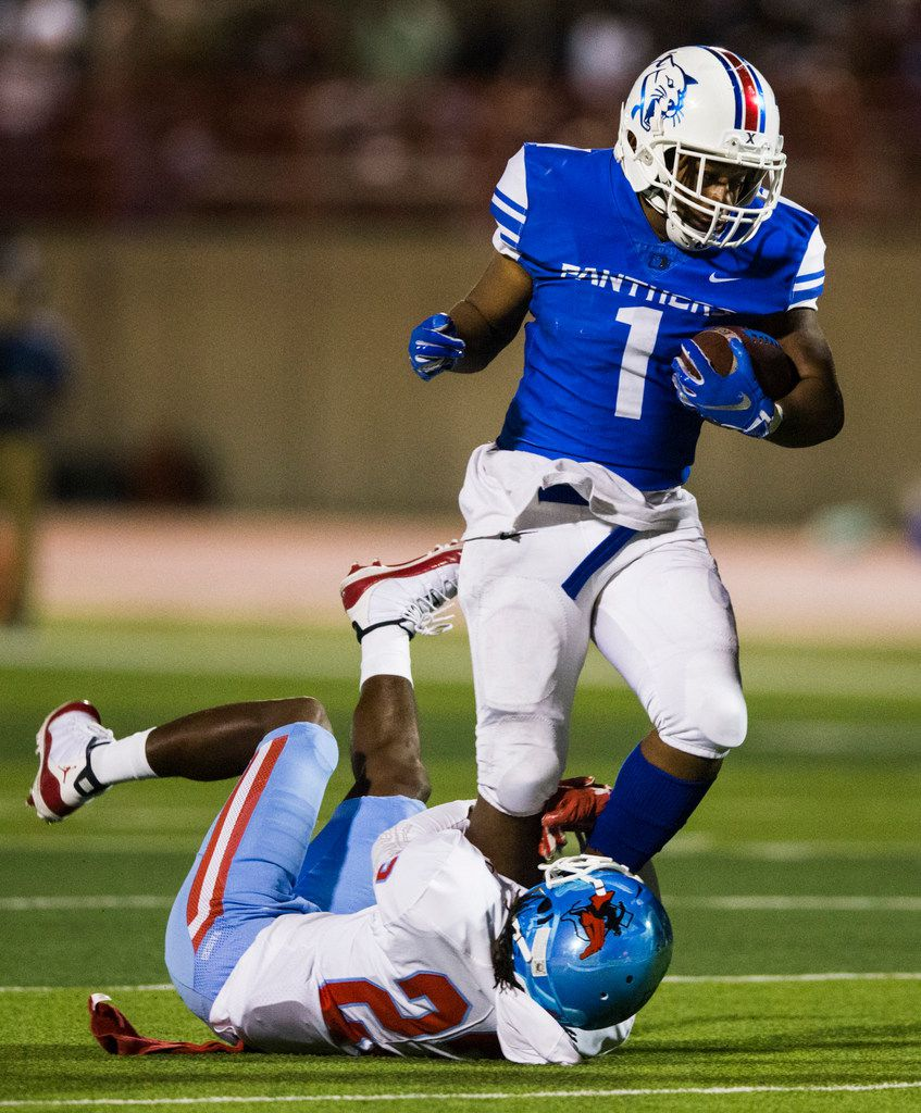 Duncanville running back Trysten Smith (1) is tackled by Skyline defensive back Rodgret Turner (23) during the second quarter of a high school football game between Skyline and Duncanville on Friday, October 4, 2019 at Panther Stadium in Duncanville. (Ashley Landis/The Dallas Morning News)