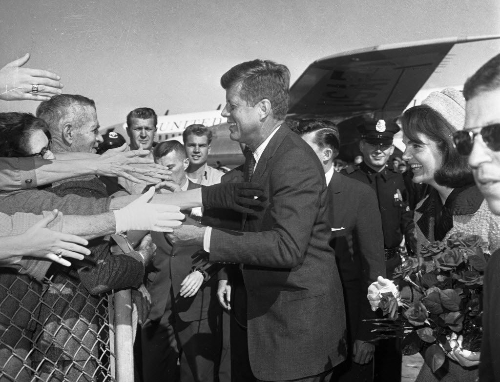 President John F. Kennedy and his wife, Jacqueline, arrive at Dallas Love Field on the morning of Nov. 22, 1963, just hours before JFK was assassinated in downtown Dallas.