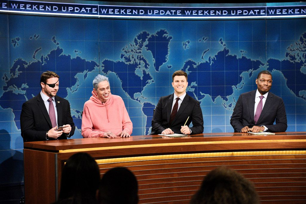 """From left:  Lt. Cmdr. Dan Crenshaw, a congressman-elect from Texas, Pete Davidson, Colin Jost, and Michael Che sat at the anchor desk on Saturday Night Live's """"Weekend Update"""" segment in New York on Nov. 10. Davidson made his apologies to Crenshaw, whose appearance he'd earlier mocked, saying Crenshaw """"deserves all the respect""""in the world."""""""