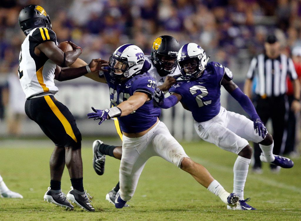 TCU Horned Frogs linebacker Garret Wallow (30) attempts to tackle Arkansas-Pine Bluff Golden Lions running back Taeyler Porter (2) during the third quarter at Amon G. Carter Stadium in Fort Worth Texas, Saturday, August 31, 2019. TCU defeated Arkansas-Pine Bluff, 39-7. (Tom Fox/The Dallas Morning News)