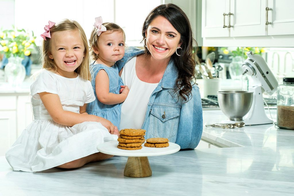 Whitney Rowell with her daughters Stella, 3, and Charlotte, 1, and a plate of her Miracle Milkookies lactation cookies on May 6, 2019, in Dallas. Rowell is the founder and CEO of Miracle Milkookies, a lactation cookie to help new/nursing mothers boost their milk production.