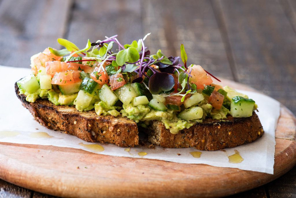 Cru Food and Wine Bar's Mother's Day brunch menu will include avocado toast with tomato-cucumber relish and extra virgin olive oil.