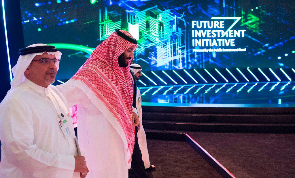 A handout picture provided by the Saudi Royal Palace on Oct. 24, 2018, shows Saudi Crown Prince Mohammed bin Salman walking with his Bahraini counterpart Crown Prince Salman bin Hamad bin Isa Al-Khalifa, during the Future Investment Initiative conference in the capital Riyadh.