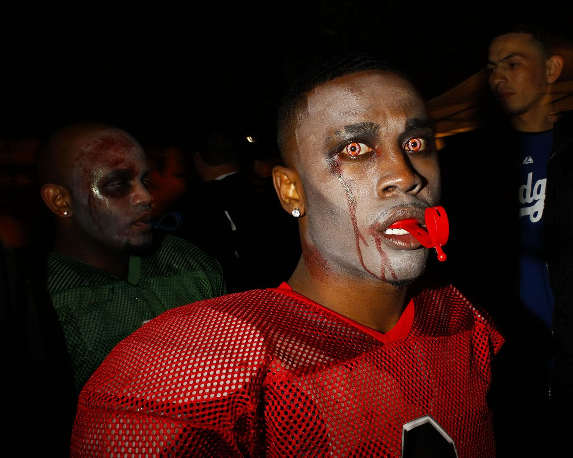 A zombie football player stares with unusual eyes on the 3900 block of Cedar Springs Road for the Oak Lawn Halloween Street Party in Dallas on Saturday Oct. 27, 2012. (Christian Randolph/The Dallas Morning News)