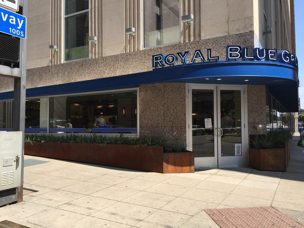 Royal Blue Grocery shares the intersection of Main and Ervay streets in downtown Dallas with Neiman Marcus. . Royal Blue opened in downtown Dallas on July 28.