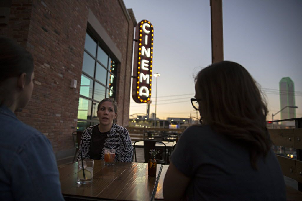 Melissa Kalka (center) talks with friends Jennifer Lopez (left) and Rachel Kirkpatrick enjoy drinks in the upstairs bar at the new Alamo Drafthouse location February 17, 2016 in Dallas. (G.J. McCarthy/The Dallas Morning News)