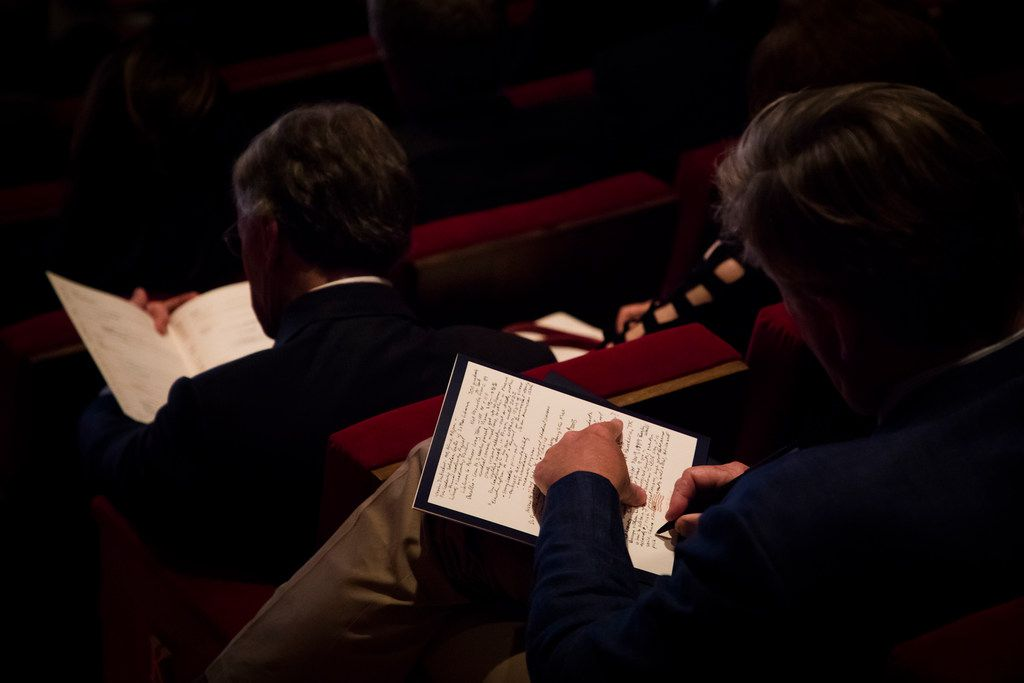 Audience members take notes during a panel discussion on Nationalism and the Future of Global Markets.