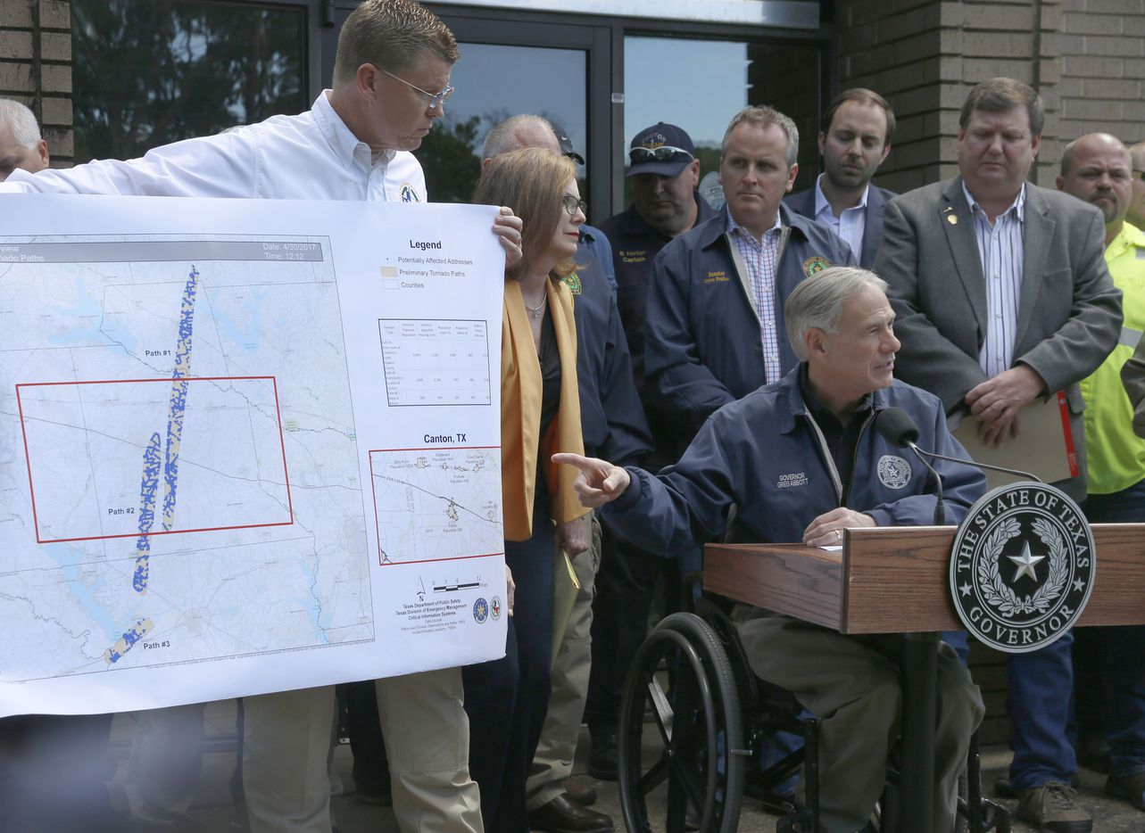 Texas Governor Greg Abbott shows the pathos the tornado'sthat touch down in east Texas near Cantonduring a press conference Sunday April 30, 2017.