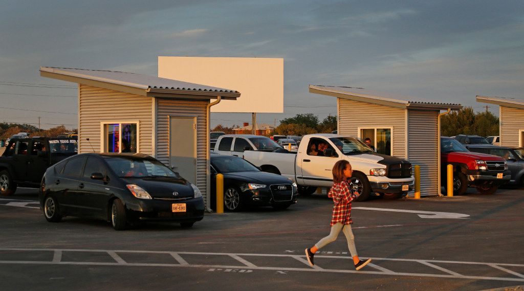 Cars line up at sunset to get into the Coyote Drive-In in Lewisville, Texas, photographed on Saturday, October 29, 2016. (Louis DeLuca/The Dallas Morning News)