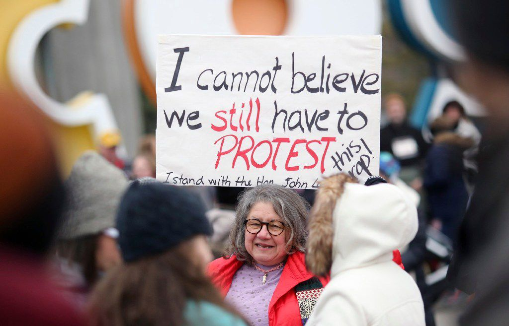 On Saturday, thousands of women will head to the nation's capital for the Women's March on Washington. Above, Diana Angus holds a sign she made for a sister march in Columbus, Ohio. (Brooke LaValley/AP)