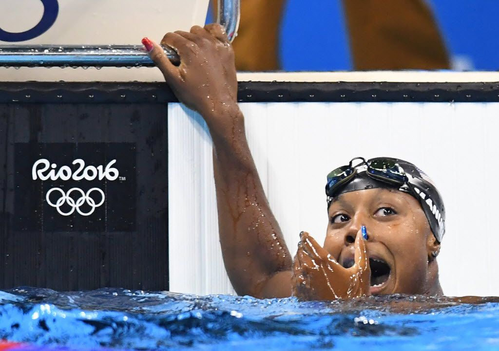 U.S. swimmer Simone Manuel reacts after seeing her first-place finish on the scoreboard in the women's 100m freestyle at the Olympic Aquatics Stadium in Rio de Janeiro, Brazil, on Thursday, Aug. 11, 2016. (Mark Reis/Colorado Springs Gazette/TNS)