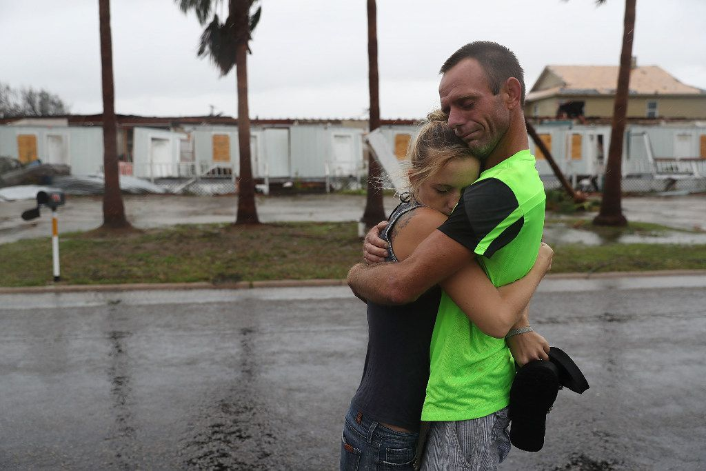 Jessica Campbell hugs Jonathan Fitzgerald (L-R) after riding out Hurricane Harvey in an apartment on August 26, 2017 in Rockport, Texas.  Jessica said is became very scary once Hurricane Harvey hit their town. Harvey made landfall shortly after 11 p.m. Friday, just north of Port Aransas as a Category 4 storm and is being reported as the strongest hurricane to hit the United States since Wilma in 2005. Forecasts call for as much as 30 inches of rain to fall by next Wednesday.