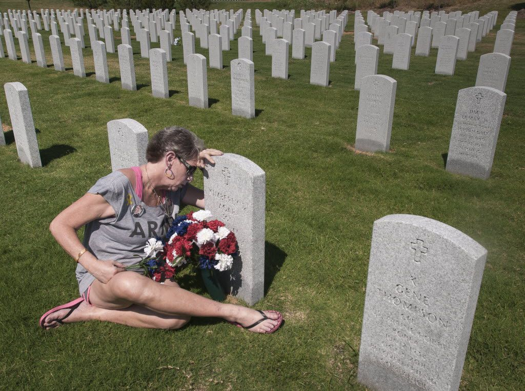 Margy Agar, visited the grave of her daughter Kimberly Agar at the Dallas-Fort Worth National Cemetery on Saturday, August 4, 2012.  Kim Agar committed suicide on Oct. 3, 2011 while stationed in Germany.  In 2007 she was injured when the vehicle she was driving was hit by an IED.    (Rex C. Curry/Special Contributor) 09162012xNEWS