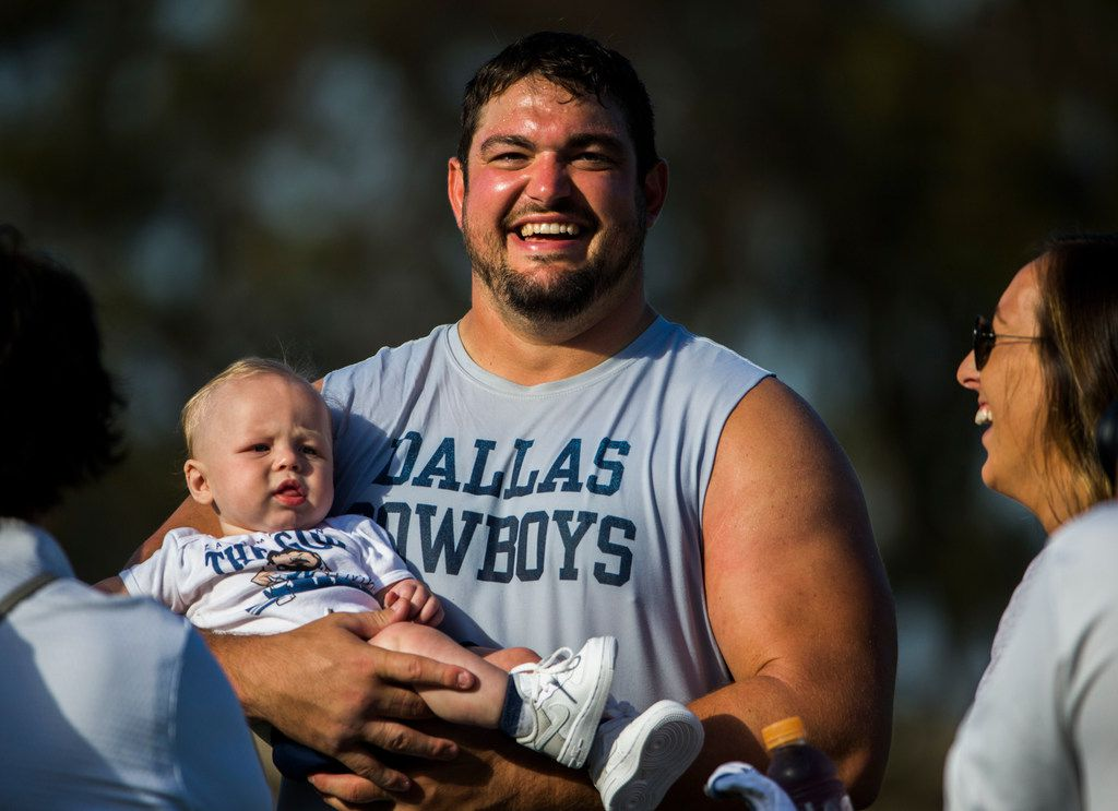 Dallas Cowboys offensive guard Zack Martin (70) greets his family after an afternoon practice at training camp in Oxnard, California on Monday, July 29, 2019. (Ashley Landis/The Dallas Morning News)
