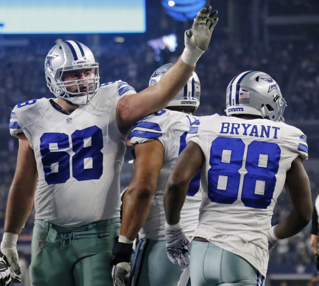 Dallas Cowboys tackle Doug Free (68) congratulates Dallas Cowboys wide receiver Dez Bryant (88) on a touchdown reception during the Detroit Lions vs. the Dallas Cowboys NFL football game at AT&T Stadium in Arlington, Texas on Monday, December 26, 2016. (Louis DeLuca/The Dallas Morning News)