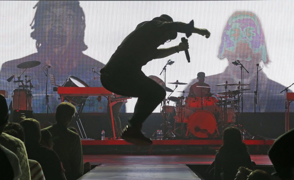 Toby Mac performs with an electronic image of former dctalk bandmates Michael Tait, left, and Kevin Max, right, at the Verizon Theatre in Grand Prairie on Saturday, December 5, 2015. (Louis DeLuca/The Dallas Morning News)