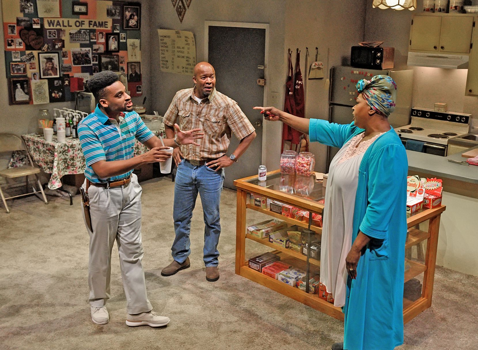 Ace Anderson (left), Leon Addison Brown and Liz Mikel star in Penny Candy at Dallas Theater Center. Trouble spreads among the characters as crack invades their Pleasant Grove neighborhood.