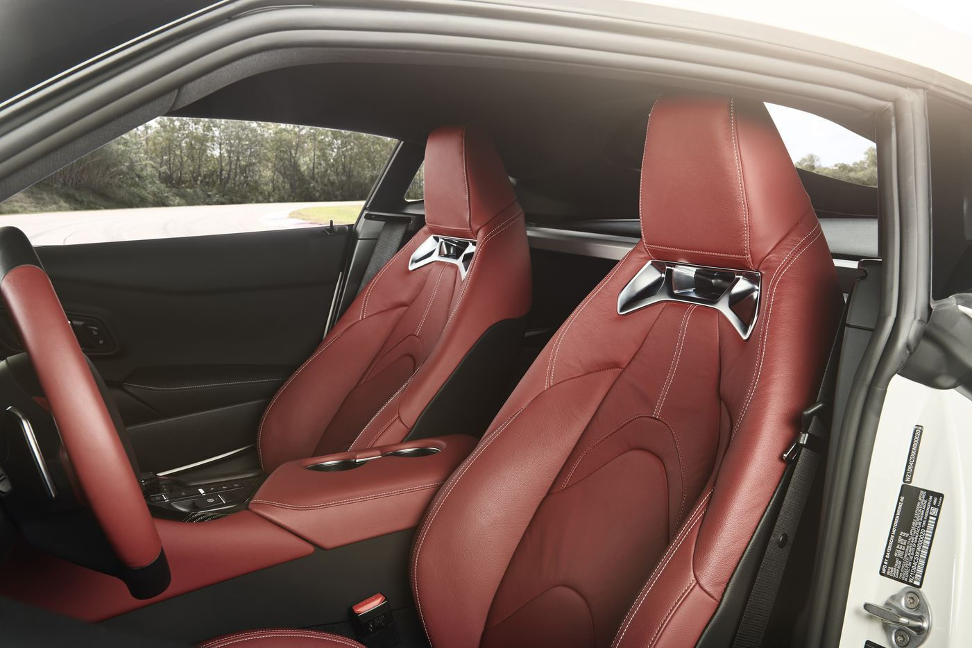 Each of the racing-inspired seats will be wrapped in red leather, with red leather steering wheel grips, and a red center console with carbon-fiber accents.