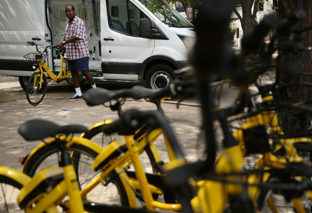 Maurice Clark said he feels a sense of pride when he sees cyclists whiz by on Ofo bikes. He keeps cards in his wallet with a code for free Ofo rides. (Andy Jacobsohn/The Dallas Morning News)