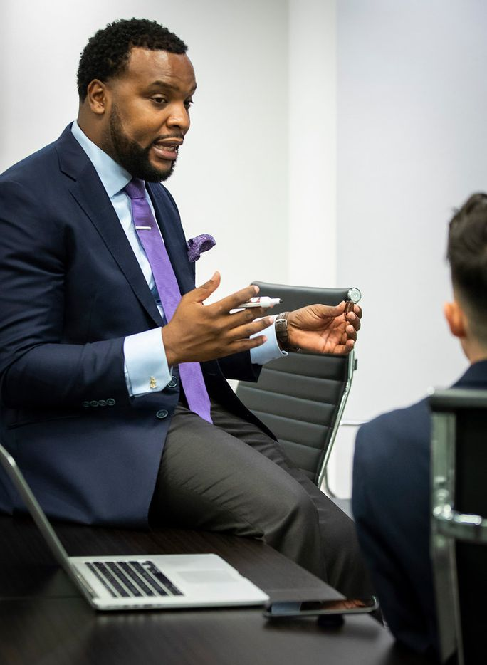 Civil rights attorney Lee Merritt (left) talks strategy in the case of Diante Yarber with intern Blerim Elmazi, a third year law student at SMU, at his downtown Dallas office on June 1.