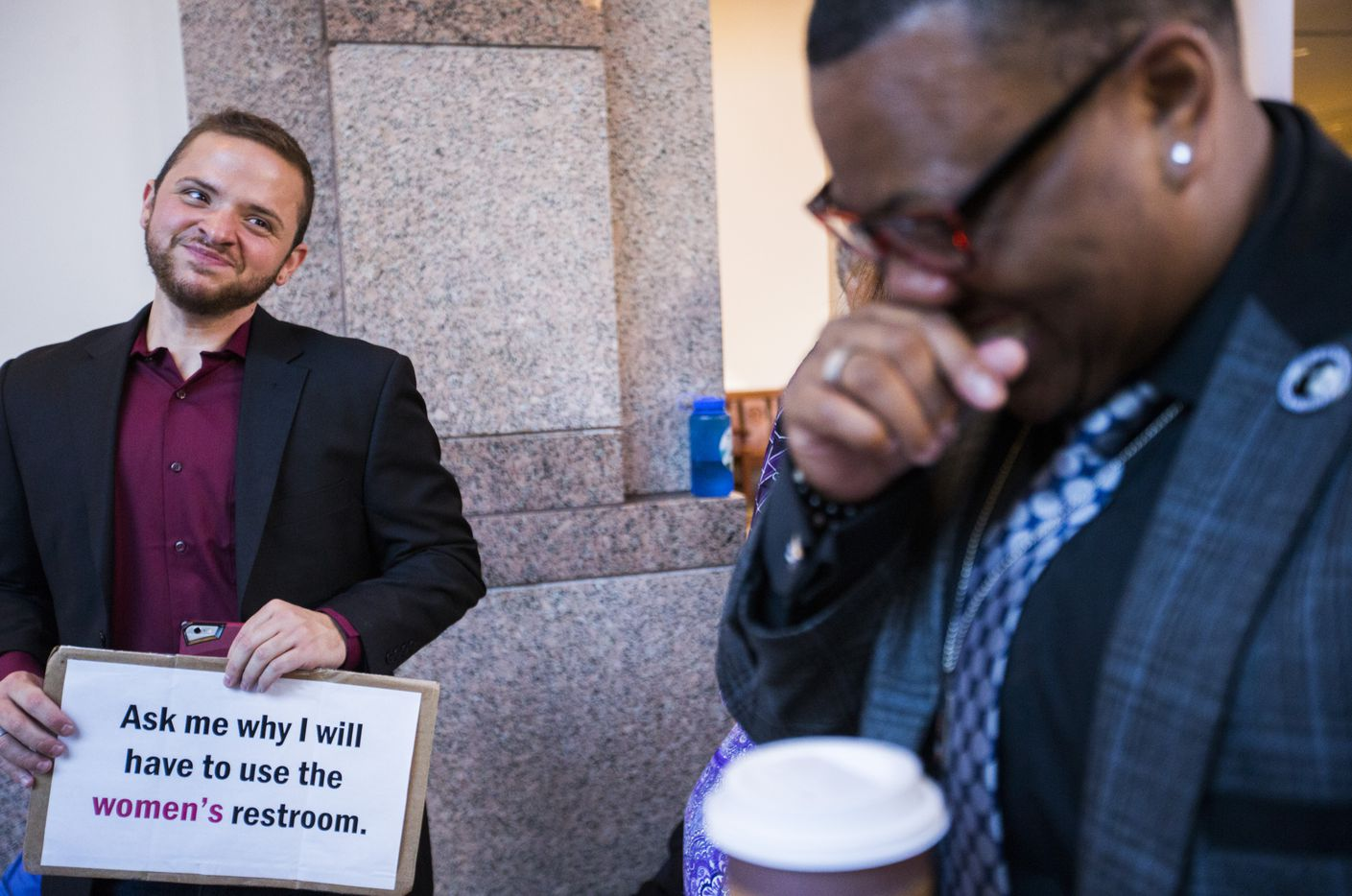 Trenton Johnson, right, jokes with Ethan Avanzino, left,  just after 7 a.m. as they stand in line to voice their opposition to the bathroom bill at a Senate State Affairs Committee public hearing on the fourth day of a special legislative session on Friday, July 21, 2017 at the Texas state capitol in Austin, Texas.