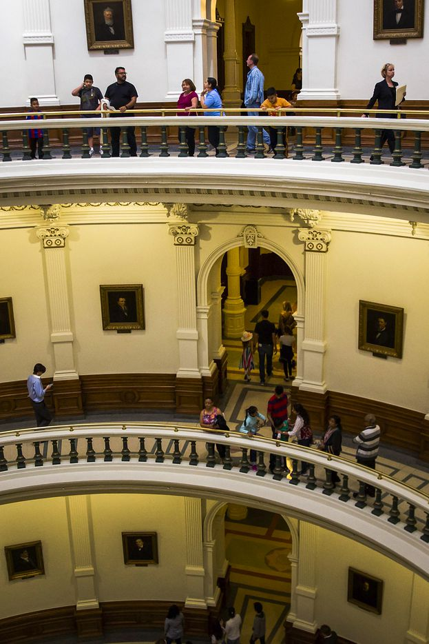 Chrisy Zartler (top right) walks around the third level of the rotunda at the Texas Capitol to her next meetings with legislators advocating medical use of marijuana on behalf of her daughter Kara on Wednesday, March 15, 2017, in Austin. (Smiley N. Pool/The Dallas Morning News)