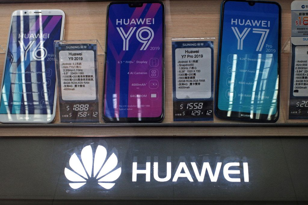 In this March 29, 2019 file photo, Huawei mobile phones are displayed in Hong Kong.