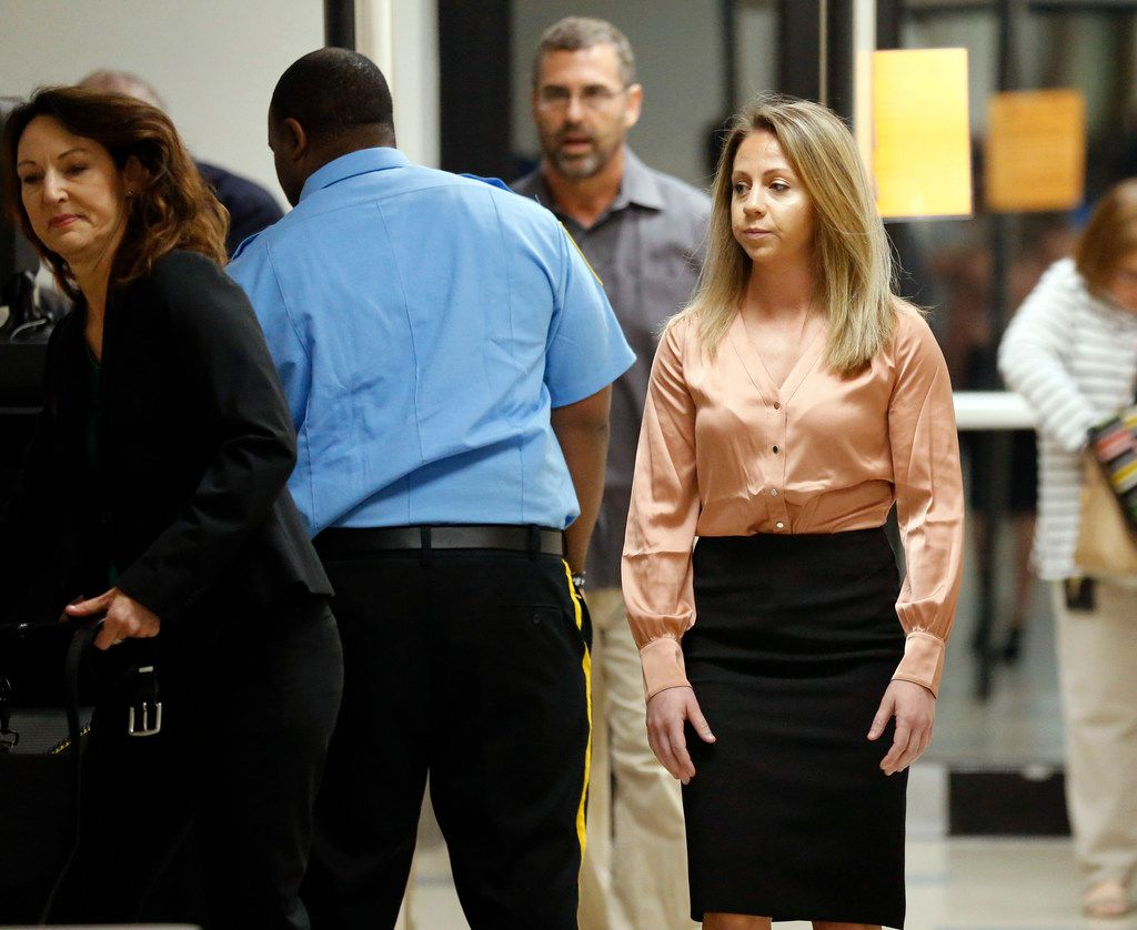 Amber Guyger (right) arrives at the Dallas courthouse during jury selection Friday for her murder trial.