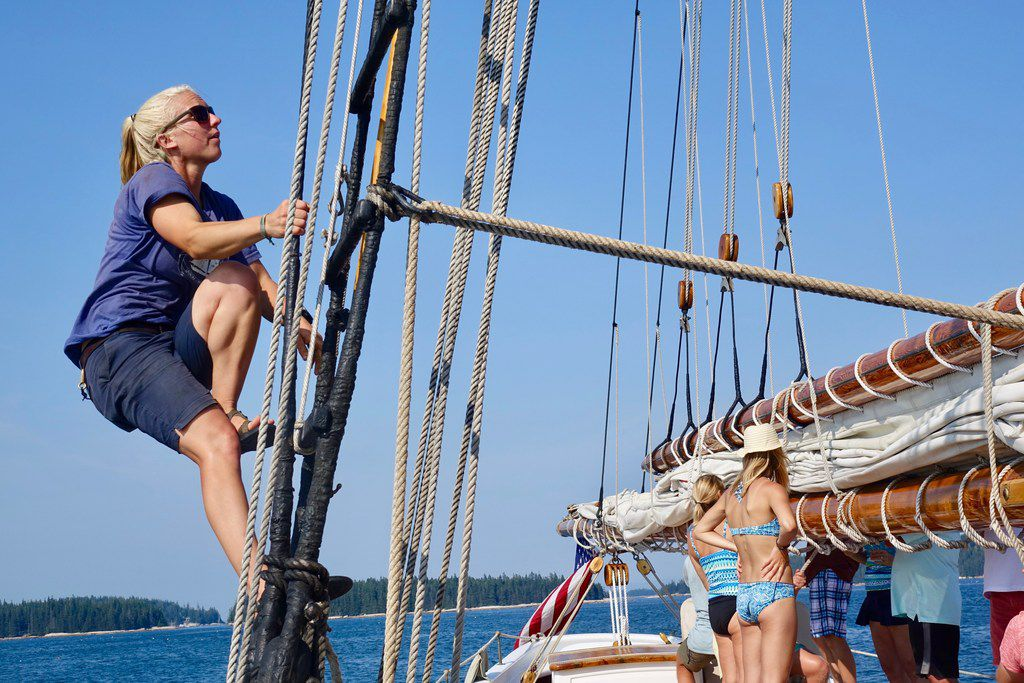 First mate Christa Miller-Shelley nears the top of the rigging on the starboard side of the American Eagle.