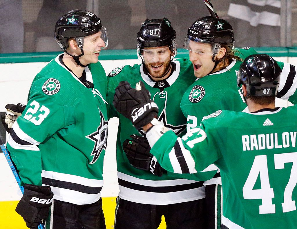 Dallas Stars center Tyler Seguin (91) is congratulated on his second period goal by teammates Esa Lindell (23), Roope Hintz (24) and Alexander Radulov (47) at the American Airlines Center in Dallas, Tuesday, February 19, 2019. (Tom Fox/The Dallas Morning News)