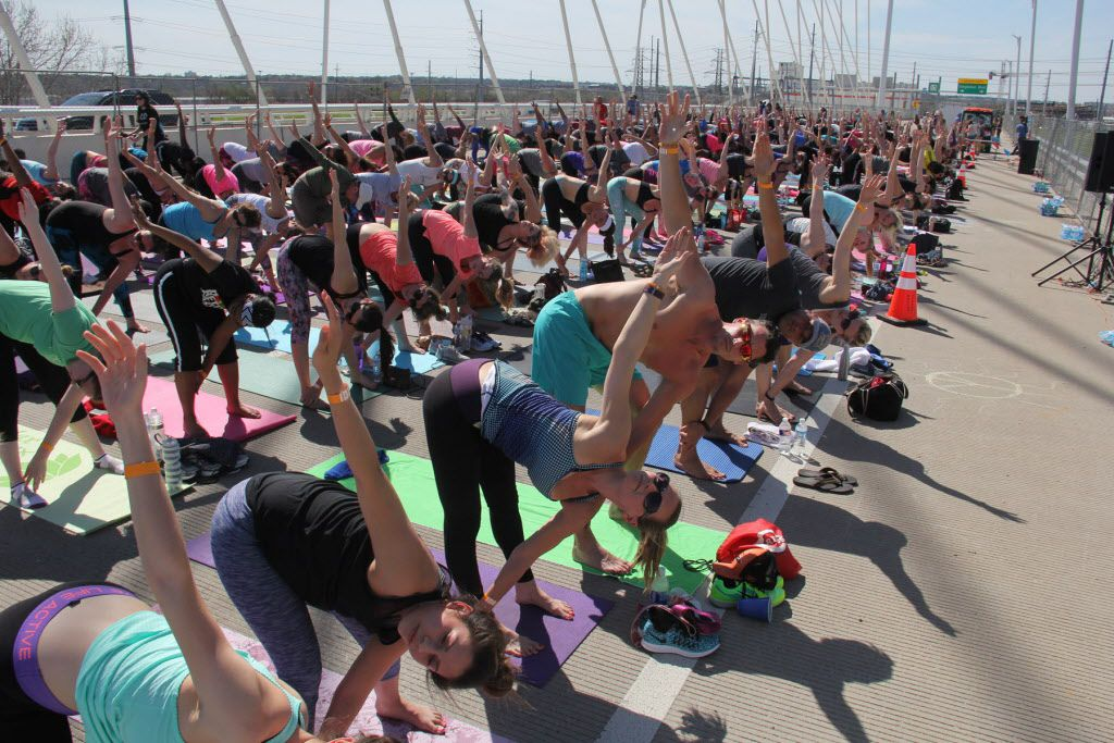 All Out Trinity hosted Dallas' fourth annual Yoga on the Bridge event on March 4, which took place on Dallas' Margaret Hunt Hill Bridge and benefited the Trinity Commons Foundation