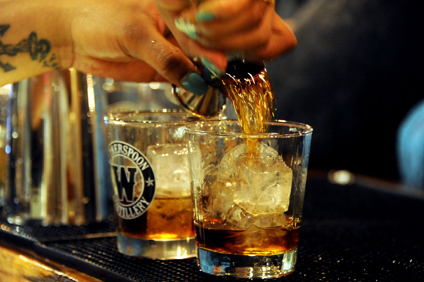 Bourbon is poured for a specialty cocktail at Witherspoon Distillery in Lewisville, TX on October 24, 2015.