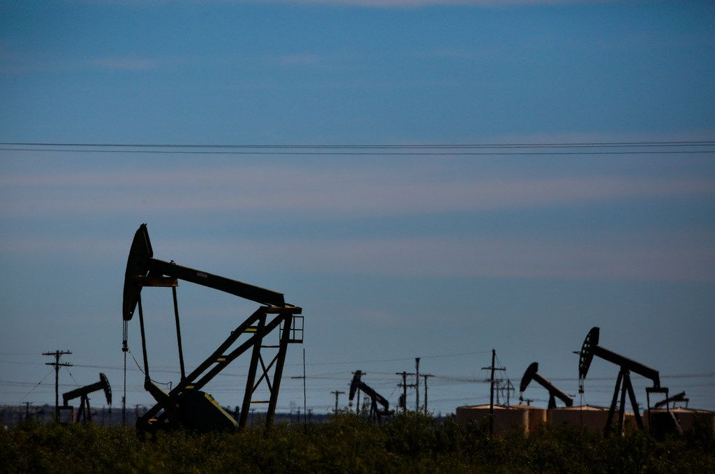 Oil pumpjacks line the horizon just west of Penwell, Texas.