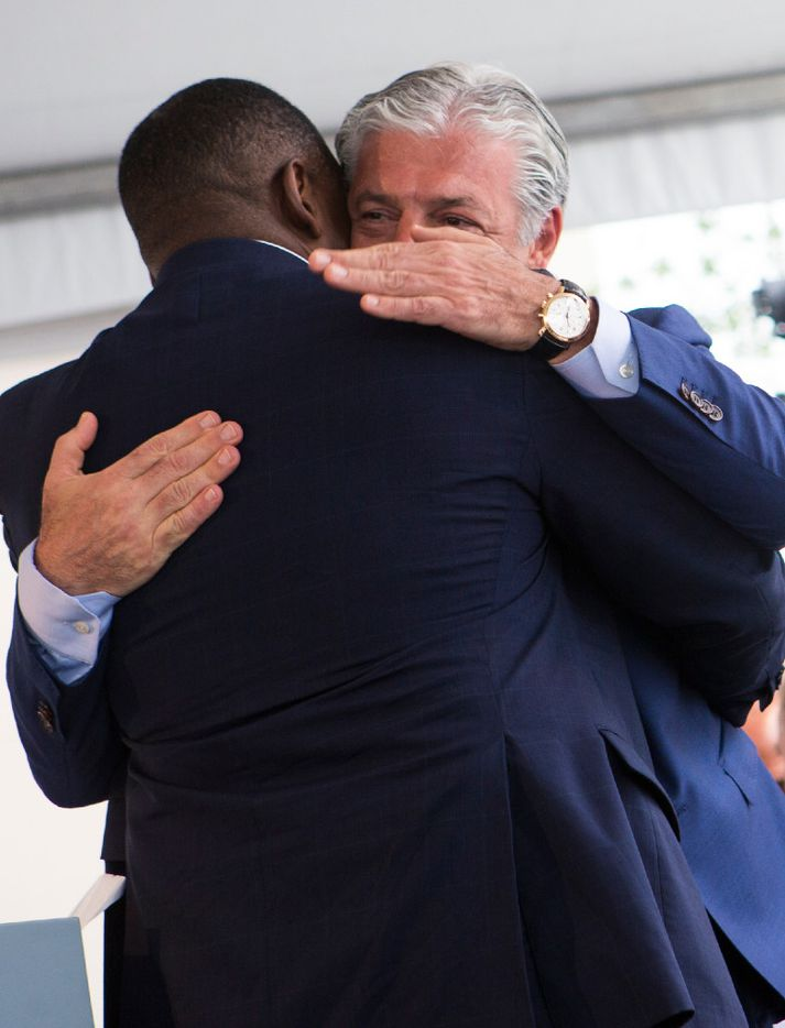 Developer Fehmi Karahan, right, embraces Plano Mayor Harry LaRosiliere during a ribbon cutting ceremony at Legacy West in Plano, Texas on Friday, Jun 2, 2017. (Ryan Michalesko/The Dallas Morning News)