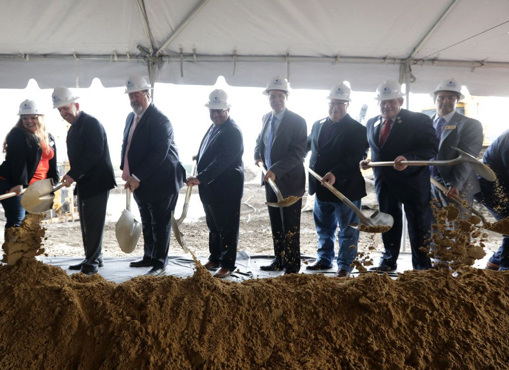 Community leaders and project VIPs break ground during an event at the new Collin College Technical Campus construction site in Allen.