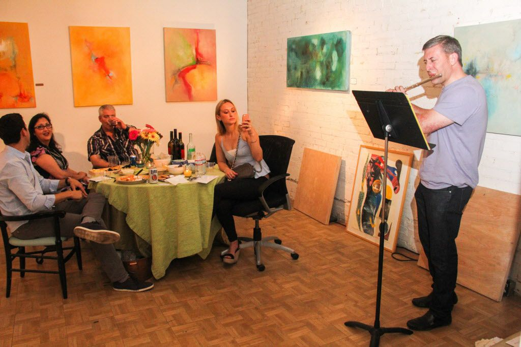 David Hill entertains guest in the studio of Fannie Brito  at the Continental Gin Building Open Studios on April 18, 2015