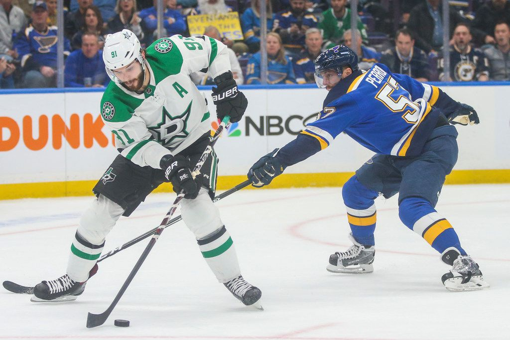 Dallas Stars center Tyler Seguin (91) makes a pass as he is defended by St. Louis Blues defenseman Colton Parayko (55) during Game 1 of an NHL second-round hockey playoff series at Enterprise Center in St. Louis Missouri on Thursday, April 25, 2019. (Shaban Athuman/Staff Photographer)