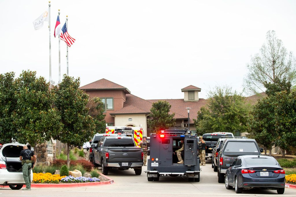 """Authorities gather at La Valencia at Starwood in Frisco, Texas on Friday, March 29, 2019. A state trooper attempted to stop a motorist on the Dallas North Tollway near Spring Creek Parkway for a traffic violation, but the driver """"elected to evade"""" and continued north, according toLonny Haschel, a spokesman for the Texas Department of Public Safety. The motorist got off the tollway at Lebanon Road and stopped in the parking lot of the La Valencia at Starwood apartments in the 6800 block of Lebanon."""