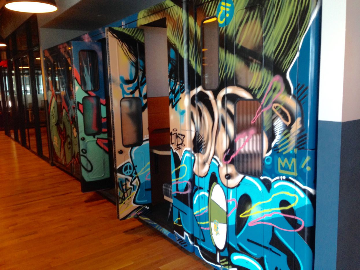 Phone booth style work pods in WeWork's office provide quiet spaces for workers to hide away or make phone calls.