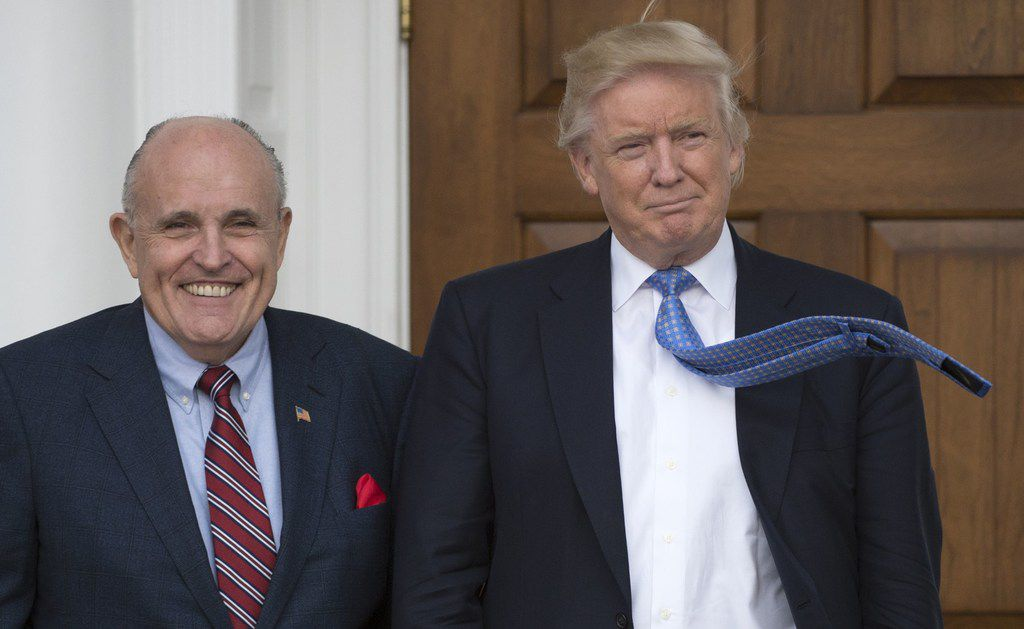 President Donald Trump (right) said payments made to his former attorney were done with his own funds and not with campaign funds. Rudy Giuliani (left), one of Trump's new lawyers, contradicted the president's claim that he didn't know anything about payments made to silence adult film star Stormy Daniels.