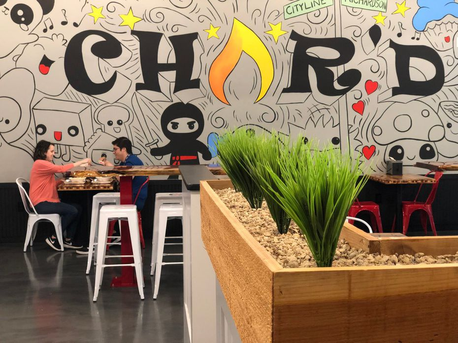 The mural at Char'd Southeast Asian Kitchen in Richardson was painted by Craig Grimston.