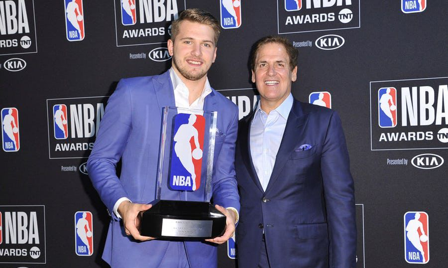 Mavericks guard/forward Luka Doncic, recipient of the NBA Rookie of the Year award, poses in the press room with Mark Cuban at the NBA Awards show on Monday, June 24, 2019, at the Barker Hangar in Santa Monica, Calif. (Photo by Richard Shotwell/Invision/AP)