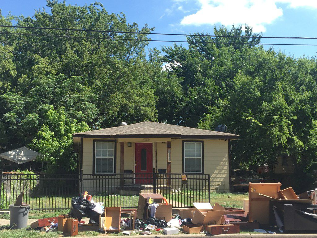 Dumped furniture and clothing lines the sidewalk in front of the Morris Street house where authorities say a Dallas couple raped, beat and drugged several sex-trafficking victims.