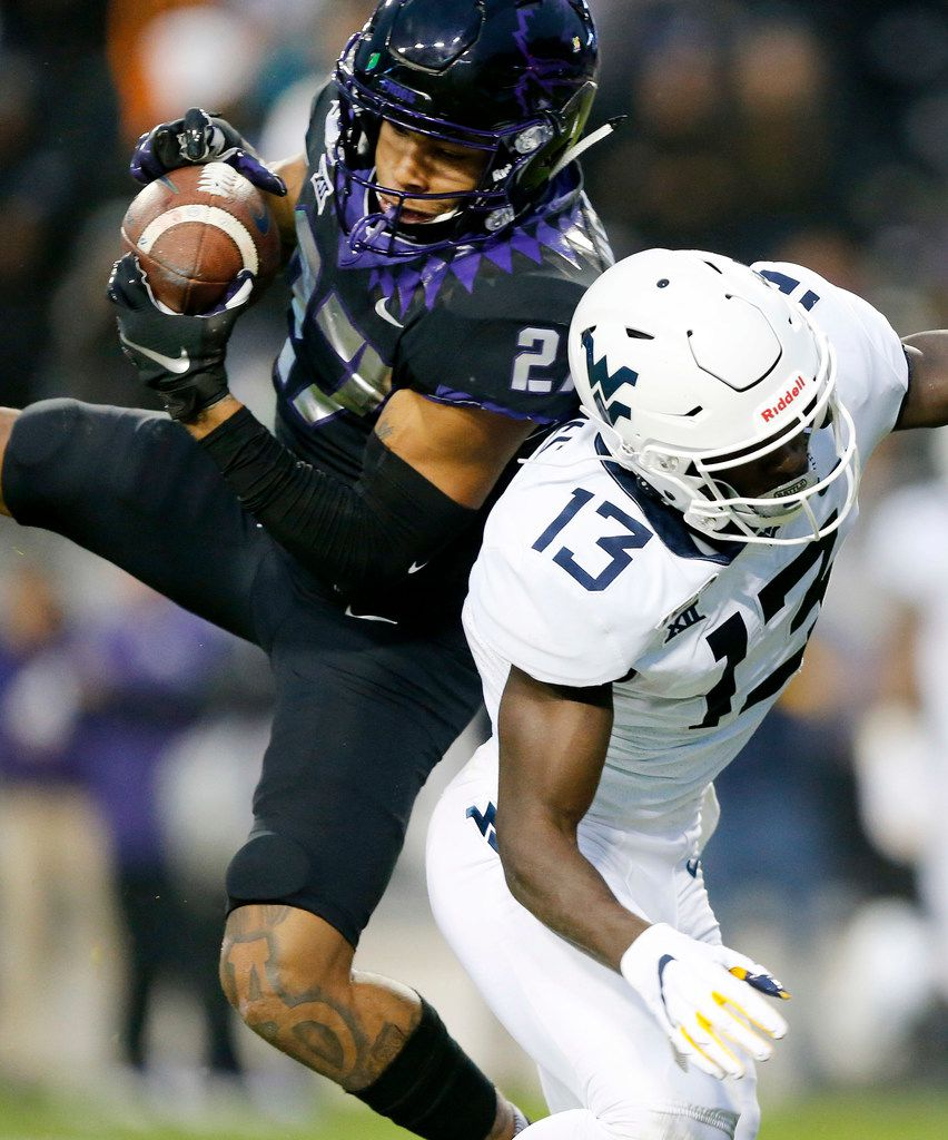 TCU Horned Frogs safety Ar'Darius Washington (27) intercepts a pass intended for West Virginia Mountaineers wide receiver Sam James (13) in the second quarter at Amon G. Carter Stadium in Fort Worth, Friday, November 29, 2019. (Tom Fox/The Dallas Morning News)
