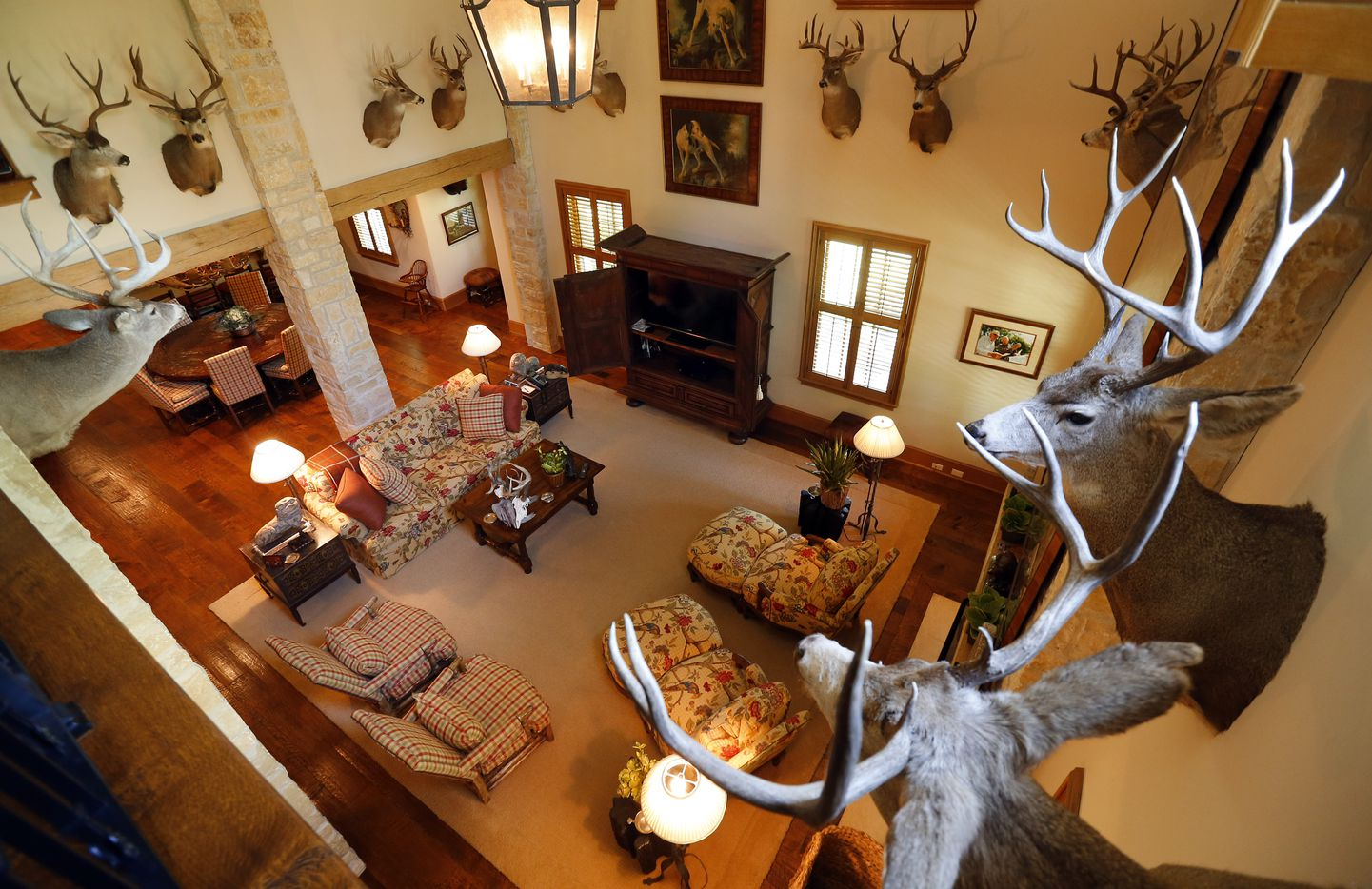 Deer mounts line the main living area of the separate family house.